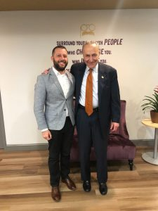 U.S. Senator Chuck Schumer for visiting posing for photo with a man in a suite