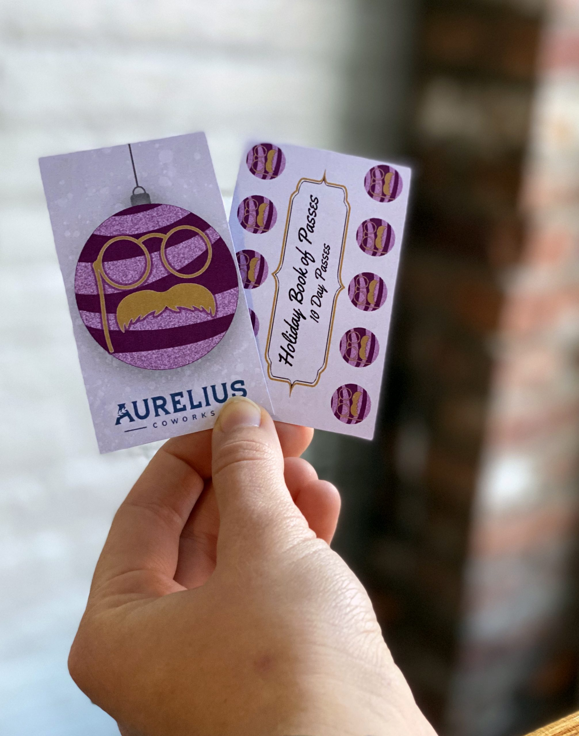 Gift Cards being held in a hand